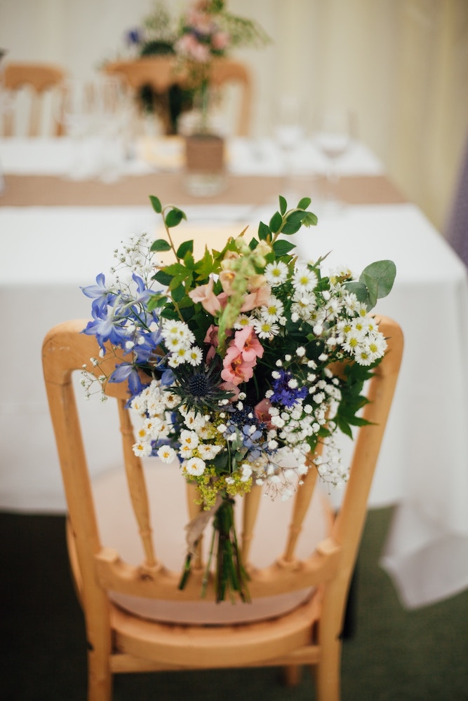 wedding decor hack, flowers tied to chairs