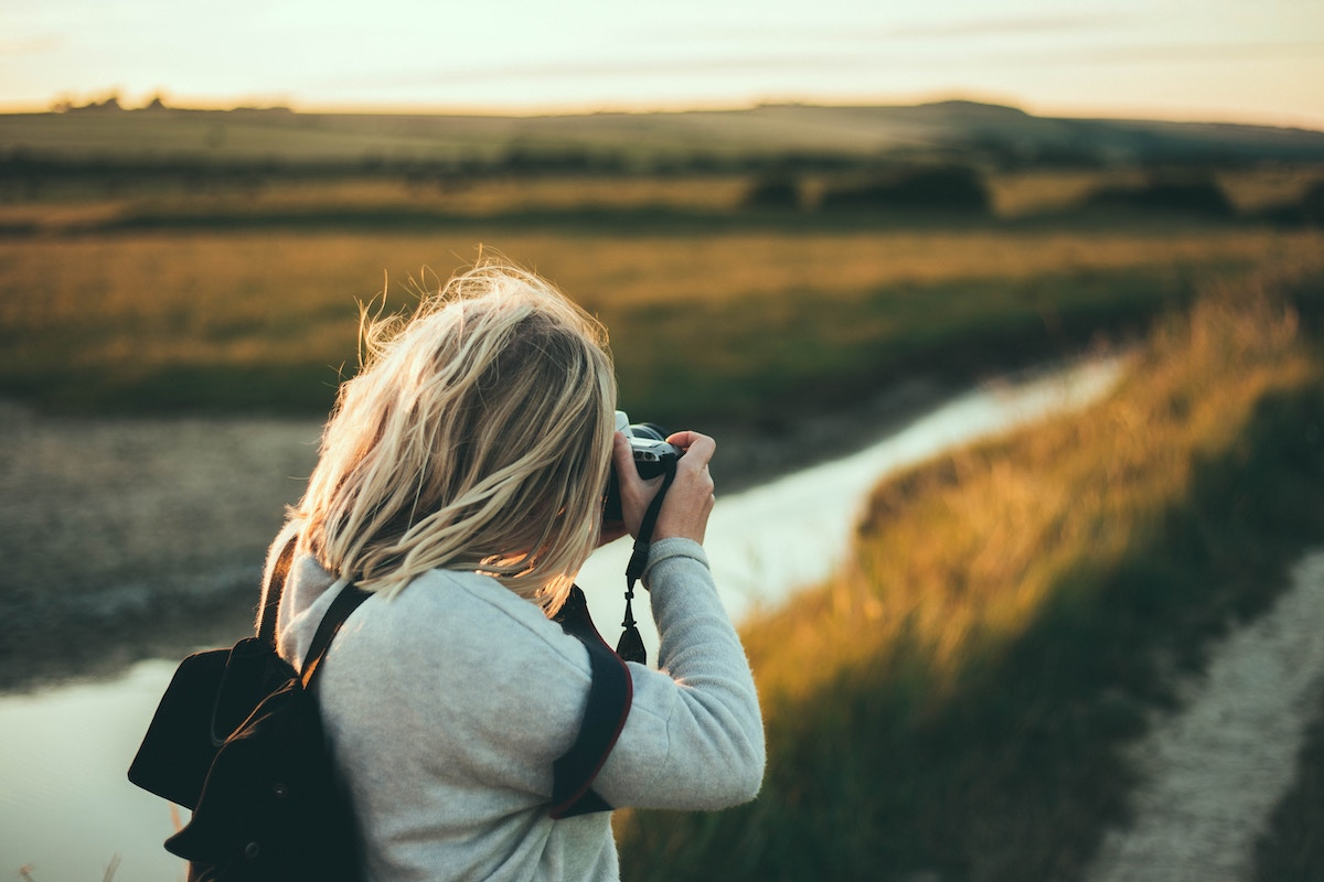 hiring a wedding photographer, photographer taking photos