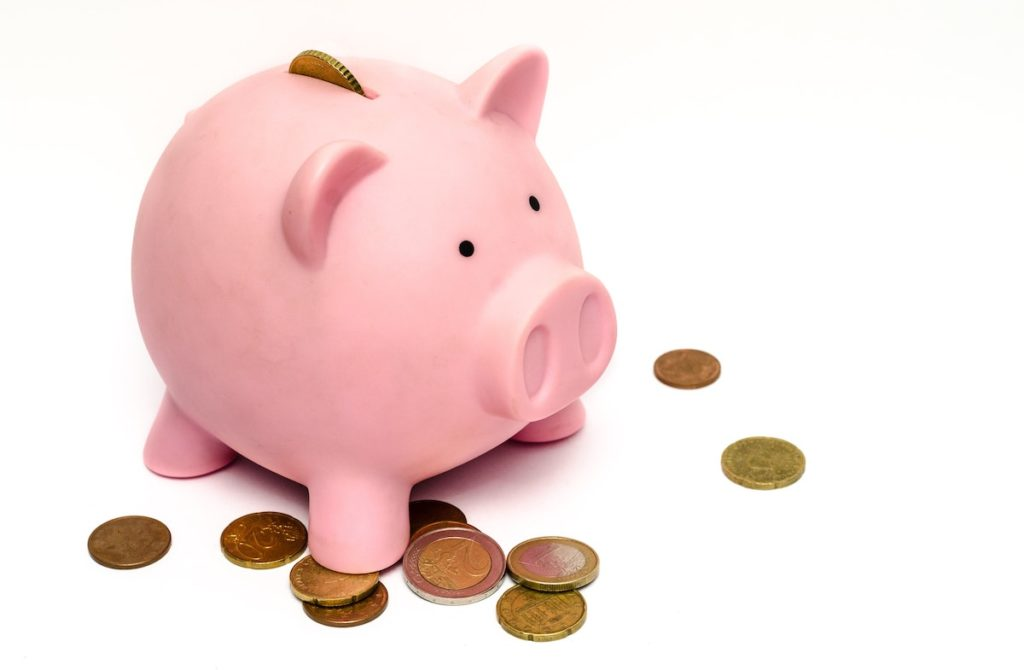 piggy bank with coins for budgeting