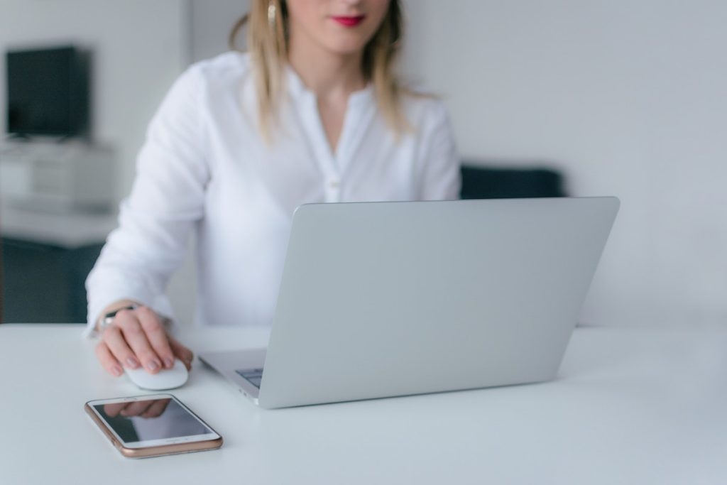 woman looking for reviews for on laptop