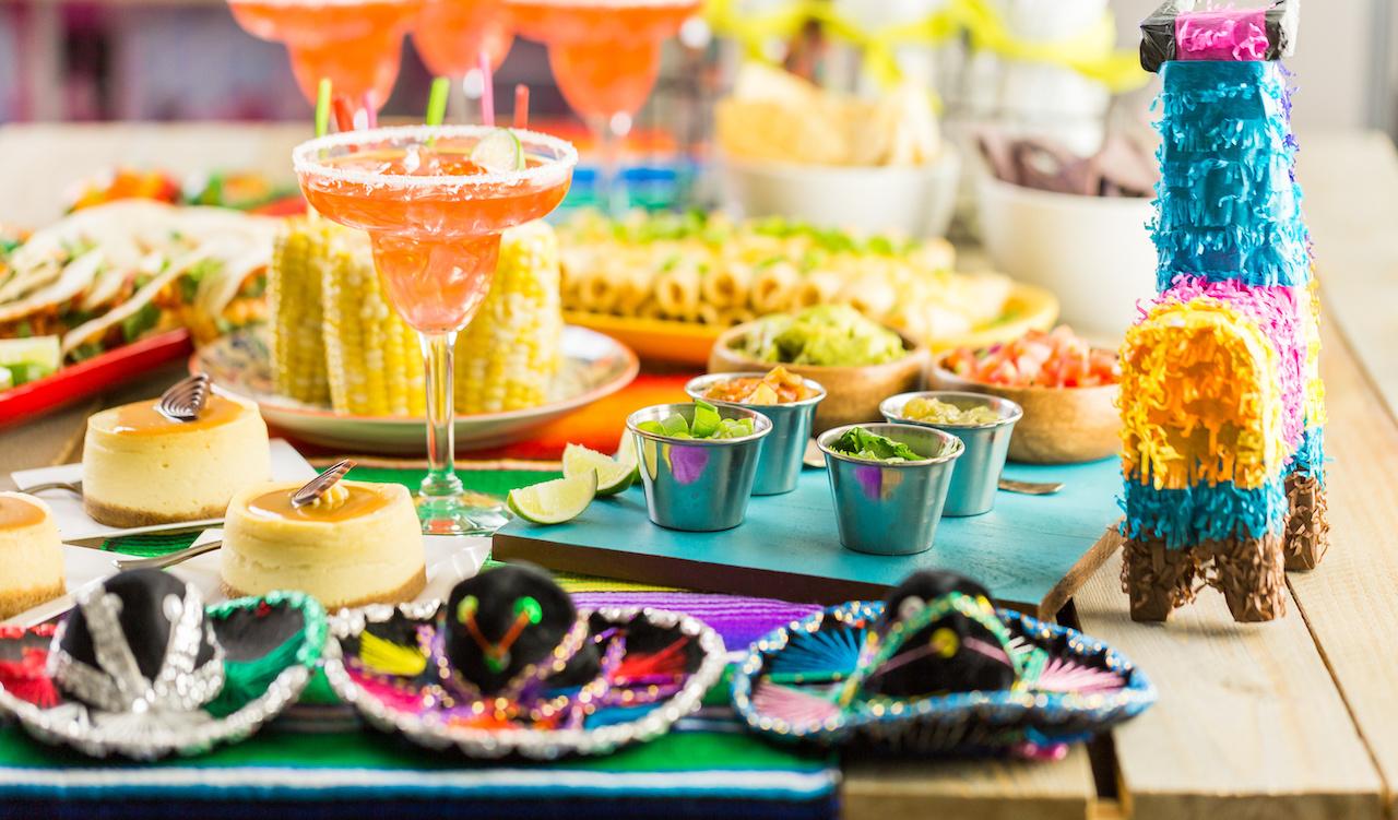 Fiesta table with a mini pinata for a Latinx celebration