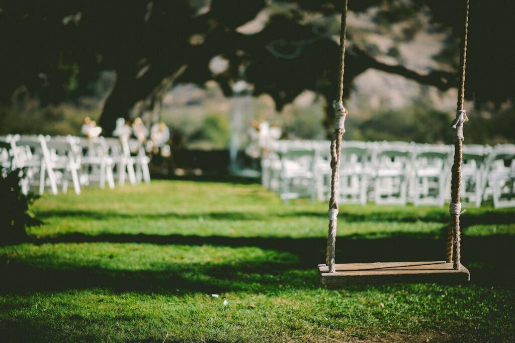 tree swing in backyard wedding