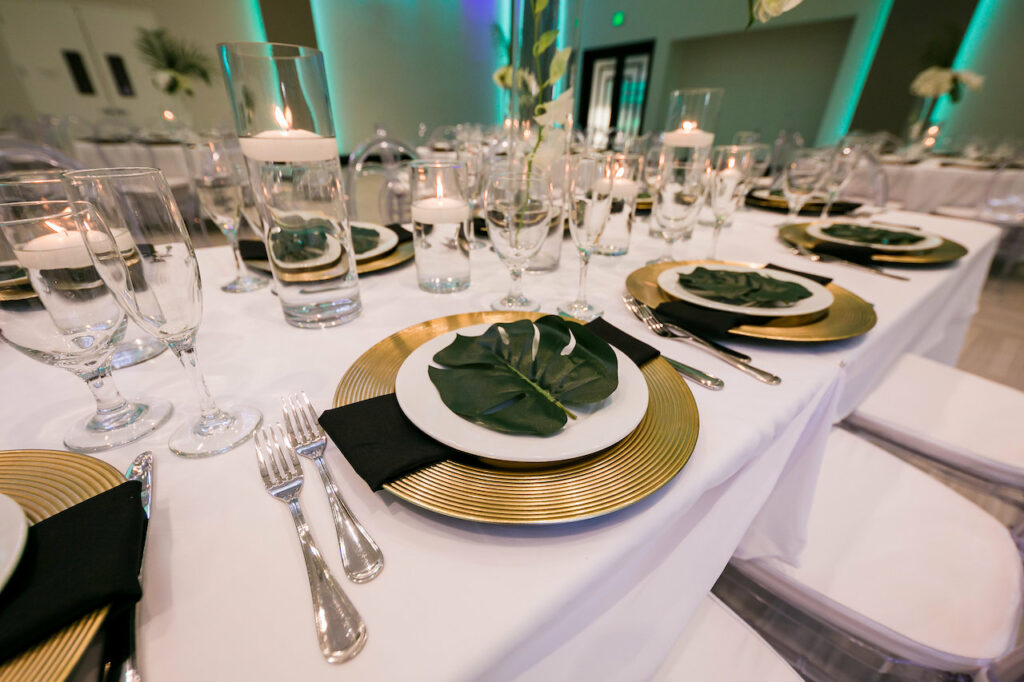 Table set with green leaves on the plates.