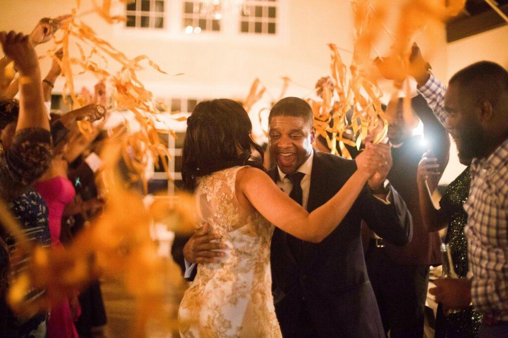 Bride and groom dancing into wedding event.