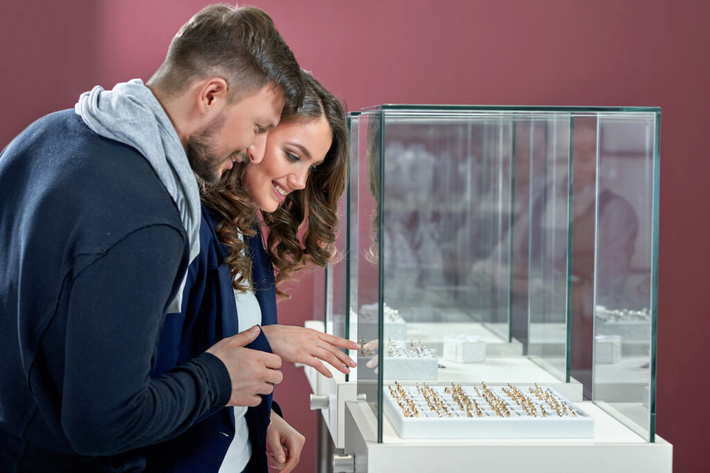 couple picking out wedding rings together