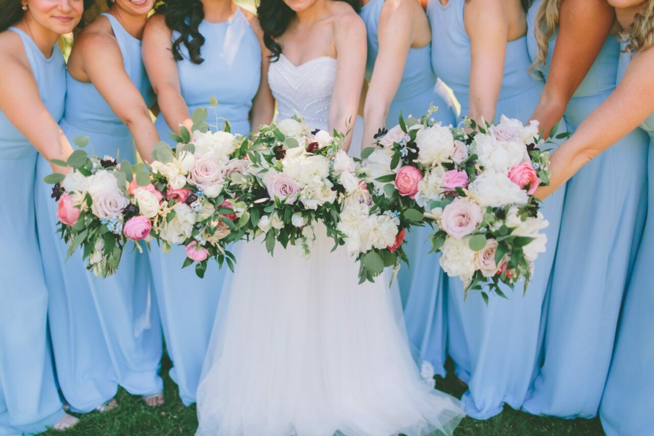 a bride standing surrounded by her bridal party