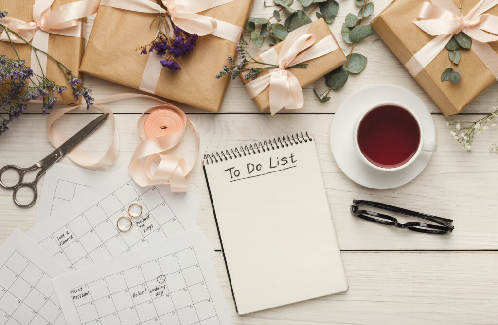 wedding to do list surrounded by presents and calendars
